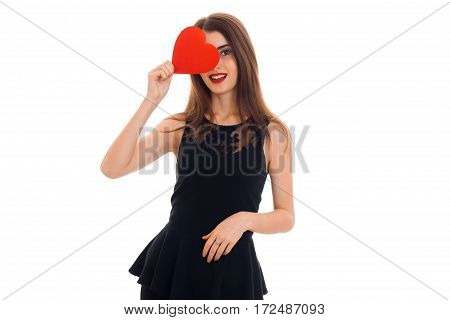 a young girl in a black dress holding a postcard sweetheart near eyes isolated on white background
