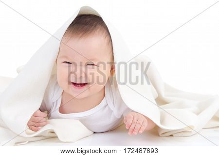 Asian baby covered with blanket laugh happily