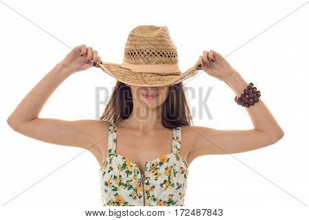 the girl wore a big hat and keeps her hands close-up isolated on white background