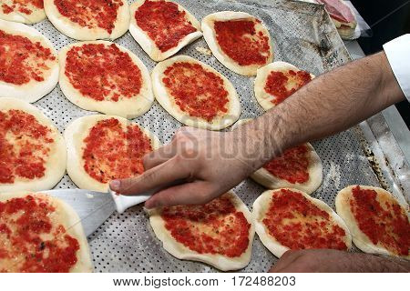 Mini pizza coming out of the oven