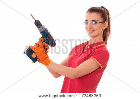 young girl in goggles holding a drill is isolated on a white