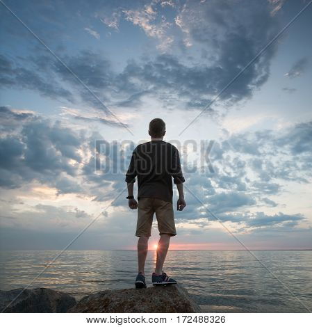 Winner silhouette on the rocks. Sport and active life concept