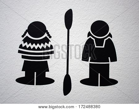 Graphic symbol icon of an Eskimo couple man an d woman in traditional clothing