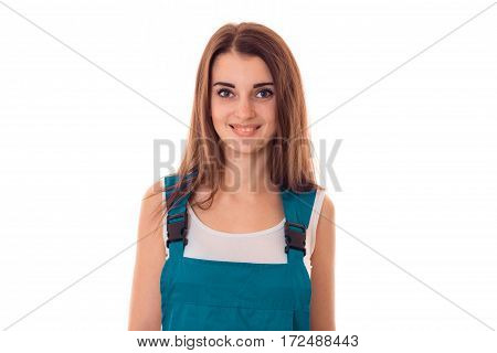 Portrait of a young smiling girl in overalls close-up isolated on white