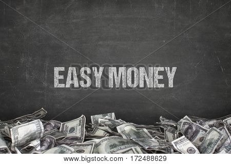 Easy money text on black background with dollar pile