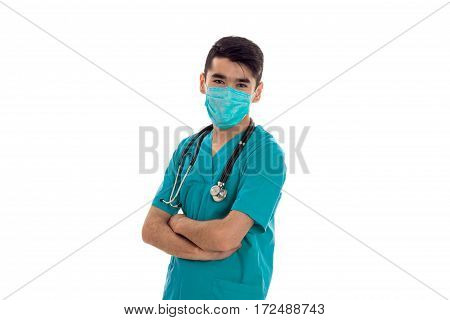 a young doctor in a sling on his face folded hands close-up isolated on white