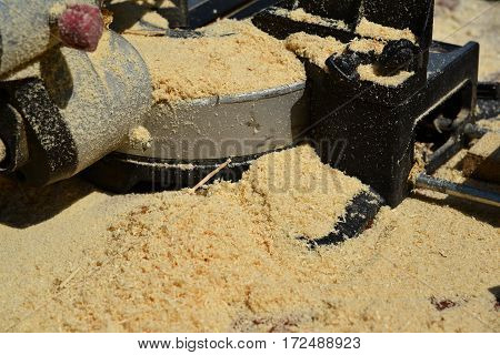 A Sawdust on the circular saw outdoors