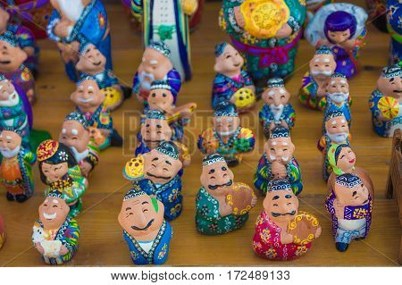 the showcase with Uzbek Souvenirs ceramic figurines of people Bukhara