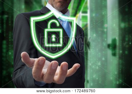 Businessman showing his empty hand against image of data storage