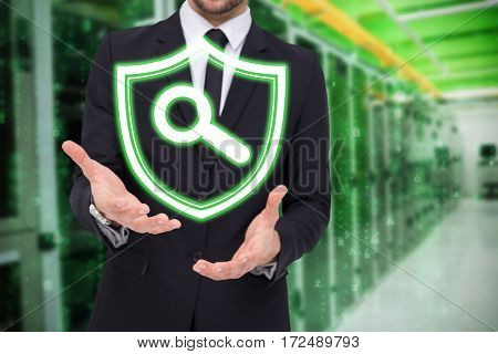 Mid section of a businessman showing with his hands against view of data technology