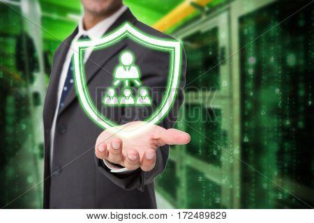 Businessman presenting against image of data center