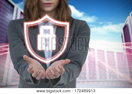 Businesswoman gesturing against white background against composite image of server towers