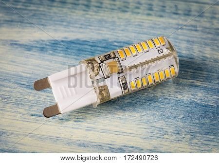 Led light bulb on wooden background