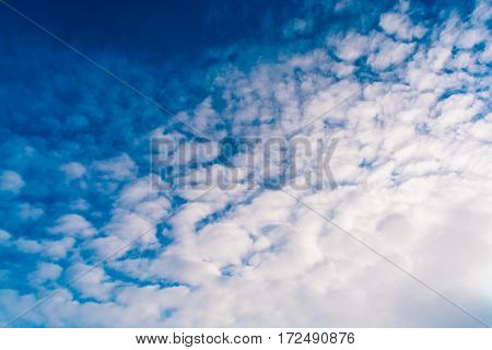 Blue sky with clouds. Winter day. tinted