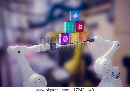 White robotic hands holding computer icons over white background against image of machinery