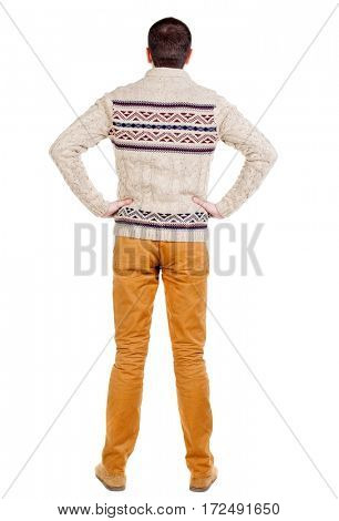 Back view of handsome man in warm sweater looking up. Standing young guy in jeans. Rear view people collection.  backside view of person.  Isolated over white background.
