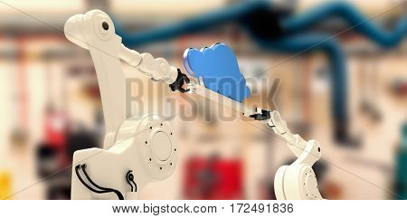 Digitally composite image of robotic hands holding cloud against workshop