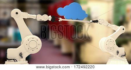 Robotic hands holding blue cloud against workshop