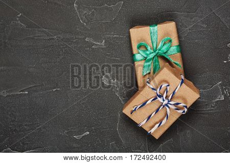 Gift Boxes In Craft Paper On Concrete Background
