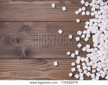 marshmallow on wooden background. Sweet food. Top view