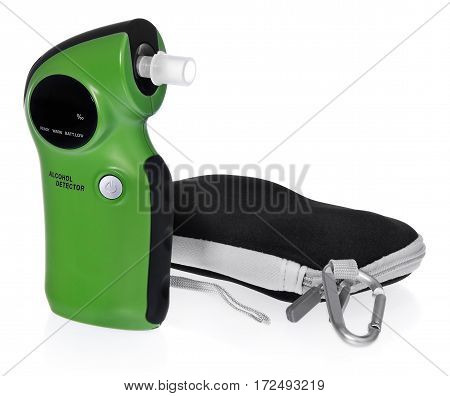 Breathalyzer with case. The device in the color green black packaging gray black. The composition on a white background with slight shadow.