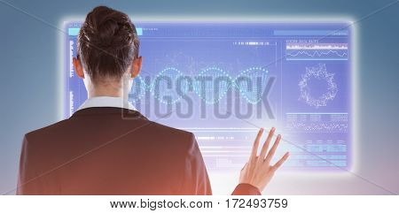 Rear view of businesswoman using digital screen against purple vignette