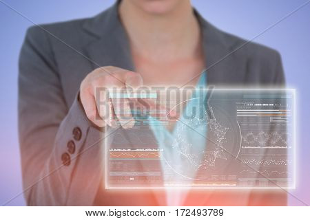 Midsection close-up of businesswoman using digital screen against genes diagram on black background