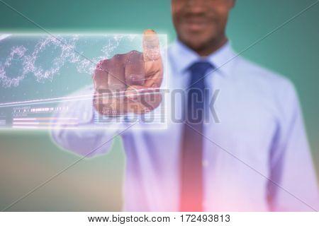 Businessman using digital screen against genes diagram on dark background