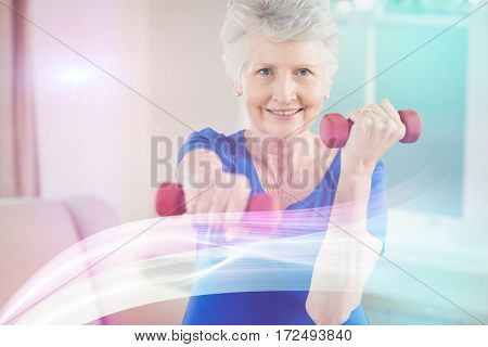 Portrait of woman exercising with dumbbells at home