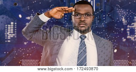 Close-up of businessman saluting against illustration of circuit board