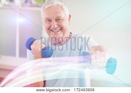 Portrait of senior man exercising with dumbbells at home
