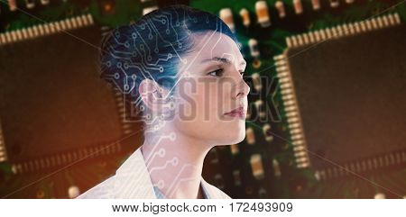 Close-up of thoughtful female scientist looking away against green and black electronic circuit