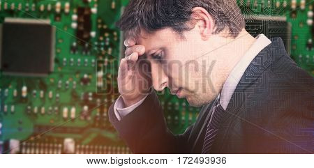Close-up of worried businessman against futuristic background with circuit board
