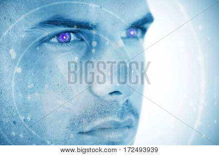 Close-up of man looking away against abstract blue pattern