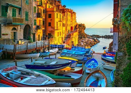 Riomaggiore village street boats and sea in Five lands on sunset Cinque Terre National Park Liguria Italy Europe.