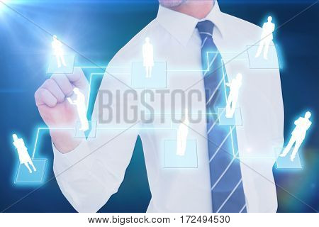 Businessman pointing with his finger against blue background with vignette