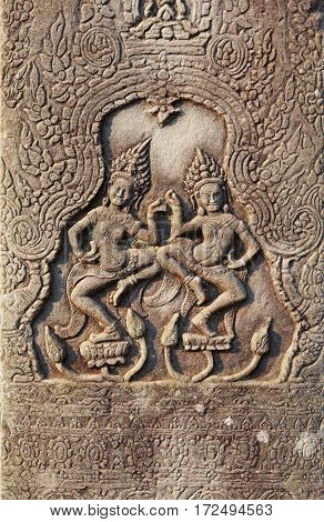 Historic Khmer bas-relief showing dancing Hindu goddesses, Cambodia