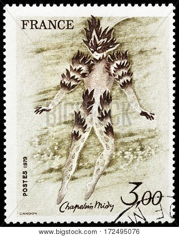 LUGA RUSSIA - FEBRUARY 7 2017: A stamp printed by FRANCE shows Fire Dancer The Magic Flute by French painter and theatre designer Roger Chapelain-Midy circa 1979