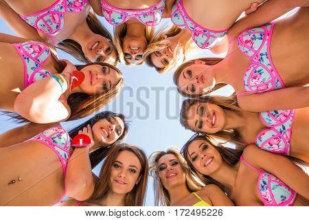 Beautiful Girls Models Standing Round In Bikinis.