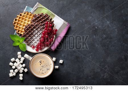 Coffee and waffles with berries. Top view with copy space for your text