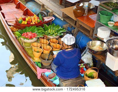 Cuisine on the boat - floating market in Bangkok, Thailand