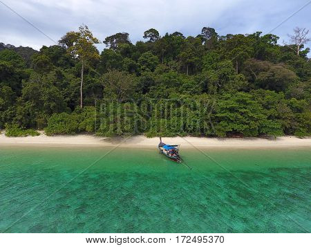 Aerial view on longtail boat and empty tropical beach in Thailand
