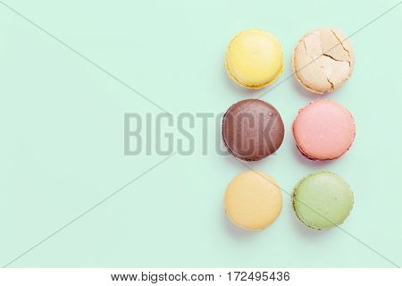 Colorful macaroons. Sweet macarons. Top view with copy space for your text. Retro toned