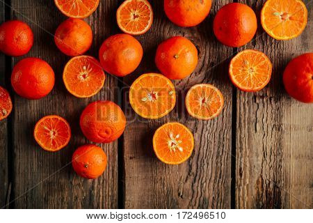 Basket of Tangerines on a wooden table. Delicious and beautiful Tangerines. Citrus background. Mandarins Tangerine Closeup. Rustic style