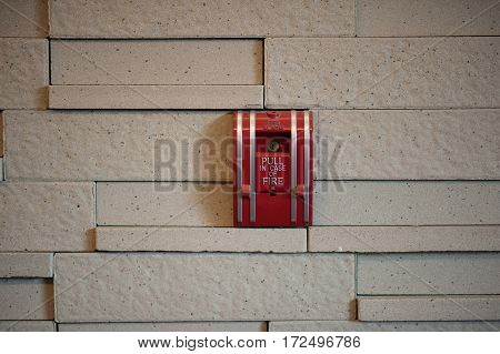 A Fire Alarm Pull Box On A Wall.