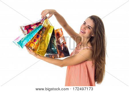 girl with long hair raised before a bright bags isolated on white