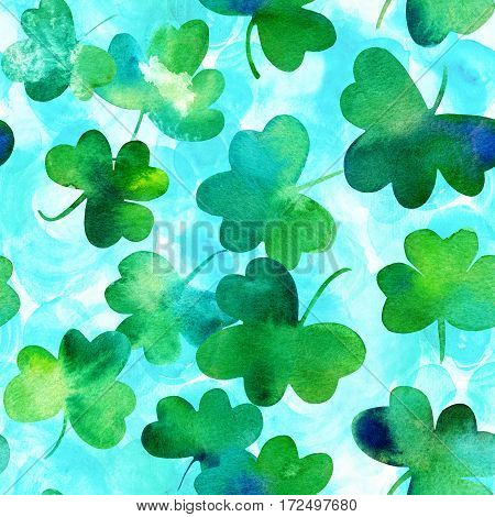 A seamless background pattern with hand drawn watercolour shamrocks on a teal background