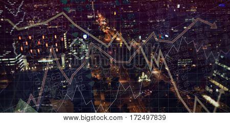 Stocks and shares against illuminated city at night