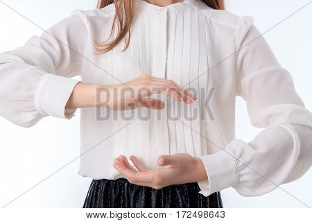a girl holds two hands behind one opposite another