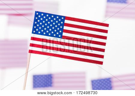Small paper flag of United States of America with flagpole
